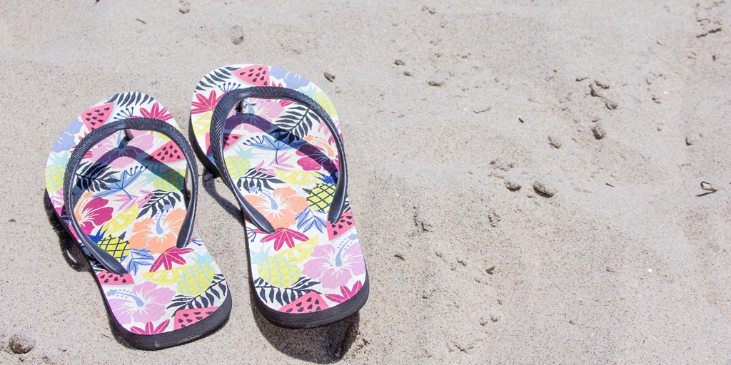 Why do so many people get foot pain while wearing flip-flops? We explain why you should ditch flip-flops and consider supportive sandals this summer!