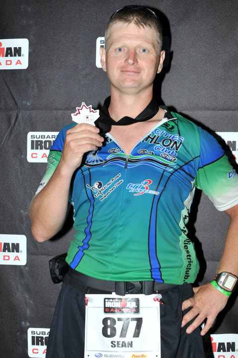 Kintec's Maple Ridge Run Clinic Instructor Sean Wilson with a medal from Ironman Canada, 2010